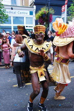 An energetic parader dancing in the street...